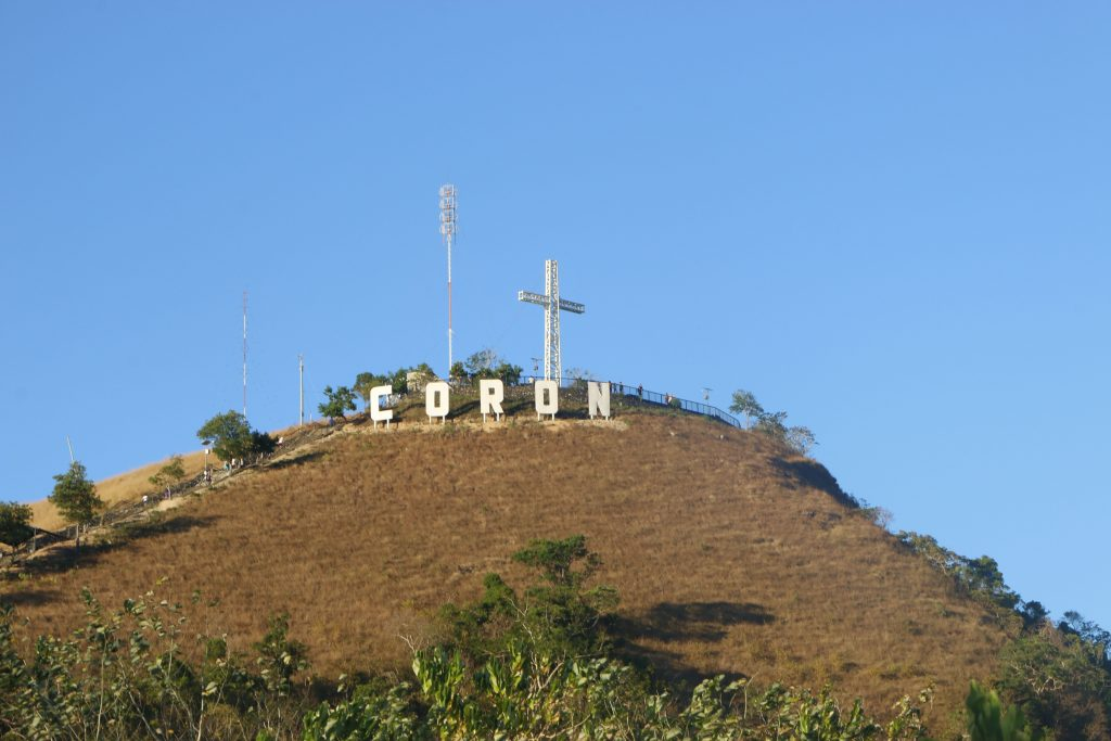 The Tapyas Mountain is the hill behind Coron with Hollywood style letters