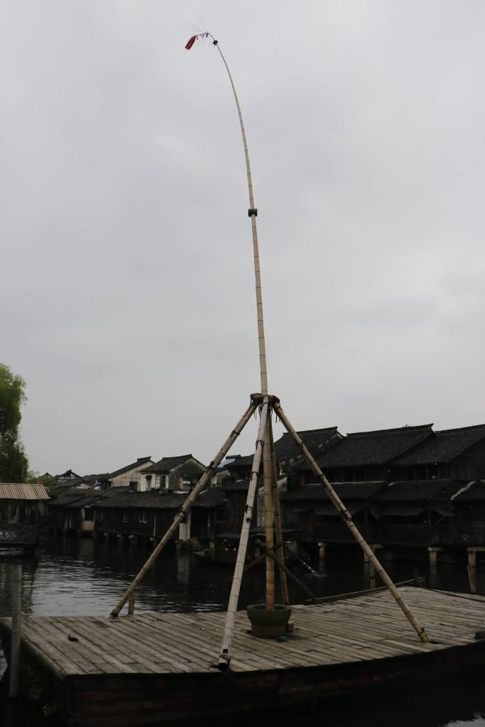 "The ""High pole boat"" is related to the harvest of silk. Sometimes you can see somebody climbing it up like a caterpillar!"